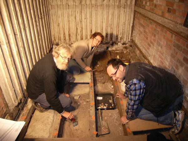 Archaeologists David Roe, left, Annita Waghorn and Martin Gibbs at work in the convict cell