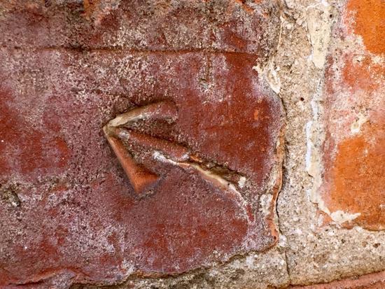 arrow on brick penitentiary